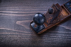 Vintage grunge planer on wooden board construction concept.  Stock Photography