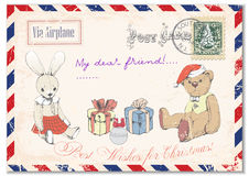 Vintage grunge postcard hand drawing of Teddy bear Teddy and rabbit on postcards, greeting merry Christmas. illustration Stock Images