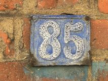 Vintage grunge square metal rusty plate of number of street address with number Royalty Free Stock Image