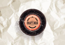 Vintage grunge style beer poster with the background of crumpled paper. Bottle top. Craft beer label. Vector illustration. Royalty Free Stock Photography