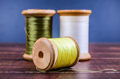 Vintage grunge three wooden threads spools Stock Photo