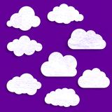 Vintage grunge ultra violet illustration of white paper clouds c. Ollection Stock Photo