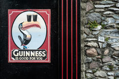 Vintage Guinness sign outside a pub Stock Photo