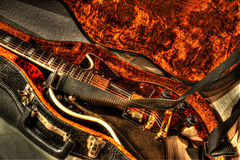 Vintage guitar. Detail of vintage black gold guitar in leather orange case Royalty Free Stock Photos
