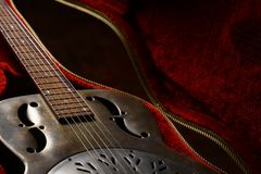 Vintage guitar in case Royalty Free Stock Image