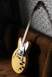 Vintage Guitar in the Dark Corner. Yellow Vintage hollow body Guitar in the Dark Corner Royalty Free Stock Photo