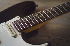 Vintage guitar. Vintage dusty electric guitar over a rustic wooden table Stock Photo