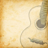 Vintage guitar. Grunge background with guitar for music design. Old guitar on vintage paper texture Stock Photography