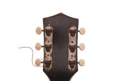 Vintage Guitar Headstock. View of vintage, rusty, cracked, worn guitar headstock, white iso Stock Images