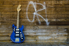 Vintage guitar from 1965 on wood background Royalty Free Stock Photos