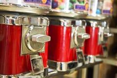 Vintage gumball dispenser machine. Vintage gumball and toy dispenser machine royalty free stock images