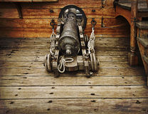 Vintage gun on ancient ship Stock Photography
