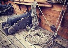 Vintage gun on ancient ship Royalty Free Stock Photography