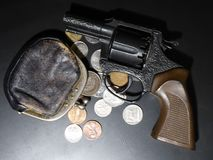 Vintage gun and coins. Money, gangster. stock photos