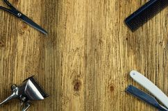 Hairdresser tools on a wooden surface. Vintage hairdressing tools on a rough wooden center surface Royalty Free Stock Photography