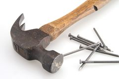 Vintage Hammer. Old vintage hammer and nails for home construction stock photos