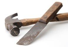 Vintage Hammer and Knife. Old vintage hammer and knife with focas on hammer end and knife stock photos
