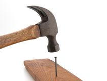 Vintage Hammer Nailing. Old vintage hammer nailing wood for construction royalty free stock photo