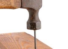 Vintage Hammer Nailing. Old vintage hammer nailing wood for construction stock photo