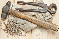 Vintage hammer with nails on wood background Stock Photo