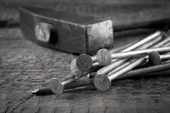 Vintage hammer with nails on wood background Stock Photography