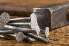 Vintage hammer with nails on wood background Royalty Free Stock Photography