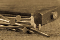 Vintage hammer with nails on wood background Stock Images