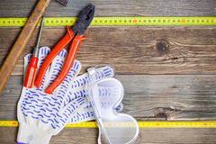 Vintage hammer, pliers, screwdriver, tape measure, gloves and sa Royalty Free Stock Photos