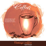 Vintage hand drawn coffee cup with beans Stock Photography
