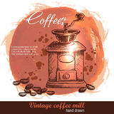 Vintage hand drawn coffee mill with lot of coffee beans. Royalty Free Stock Photography