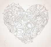 Vintage hand-drawn doodles heart background in sepia. Stock Photo