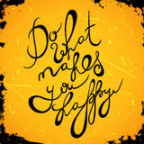 Vintage hand drawn lettering quote Do what makes you happy on grunge background. Stock Photos