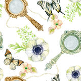 Vintage hand mirror with flowers and butterfly Royalty Free Stock Photography