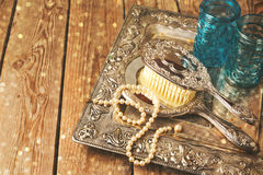 Vintage hand mirror and hairbrush on silver tray Stock Images