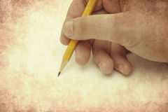 Vintage Hand with Pencil Stock Photos