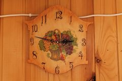 Vintage handmade clocks on the wool wall Royalty Free Stock Photography
