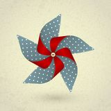Vintage handmade red and blue pinwheel with dots Stock Image