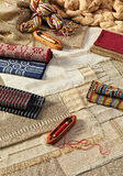 Vintage handmade textiles. Tools and woven traditional textile industry stock photo
