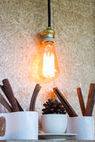Vintage hanging light bulb decorated on brown wall Royalty Free Stock Photos