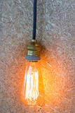 Vintage hanging light bulb decorated on brown wall Stock Image