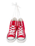 Vintage hanging red shoes. On pure white background Royalty Free Stock Photos