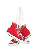 Vintage hanging red shoes tied. On pure white background Stock Photography