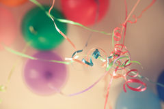Vintage happy birthday party background with colourful tied ribbons and balloons in blue tone Royalty Free Stock Photo