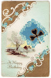 Vintage Happy Birthday Postacard. Vintage Birthday postcard from the 1910s. Gold and white boarder with blue forget-me-not flowers, a heart shaped clover Royalty Free Stock Photography