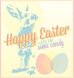 Vintage Happy Easter Card. A retro style happy Easter card with bunny and colored eggs and lets eat some candy tag line Royalty Free Stock Image