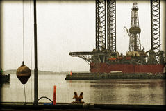 Vintage harbour and oil rig Royalty Free Stock Photo