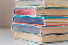 Pile of colorful hardcover vintage books on table royalty free stock photo
