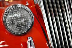 Vintage headlight. Color detail on the headlight of a vintage car royalty free stock photo