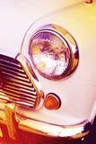 Vintage headlight white car Stock Image