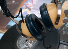Vintage headphone and old vinyls Royalty Free Stock Images